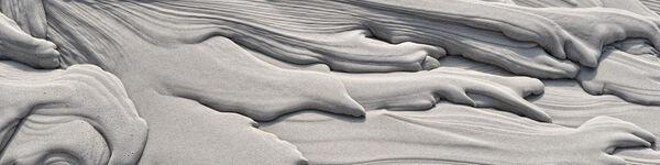 Sludge bed mud formations  - grey layers of drying sludge