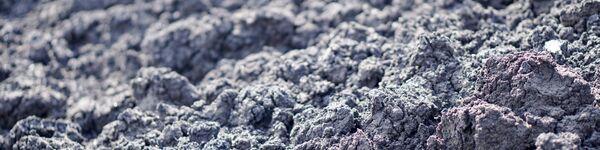 Dried sludge, in grey, close up shot