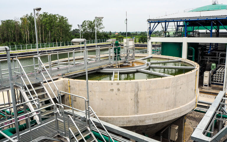 Sludge  cylindrical sedimentation tank with a galvanised metal platform and railings above it