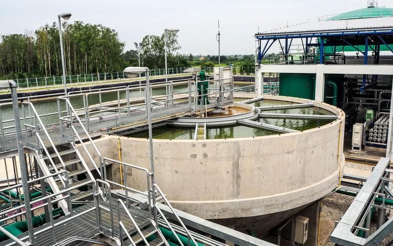 Sludge  cylindrical sedimentation tank with a galvanised metal platform and railings above it
