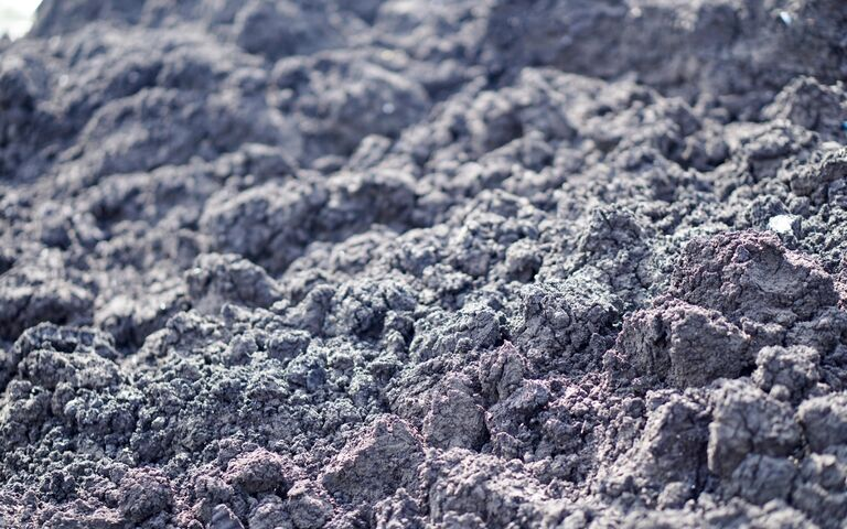 Dewatered sludge solids: large lumps of sludge formed from the removal of water from raw sewage sludge