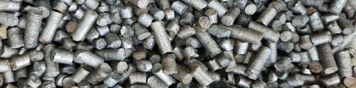Thin cylinders of sludge (pelleted, pyrolysed sewage sludge)