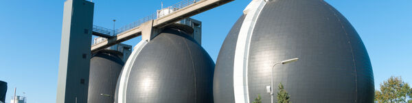 An image of three egg-shaped reactors used for the anaerobic digestion of sewage sludge